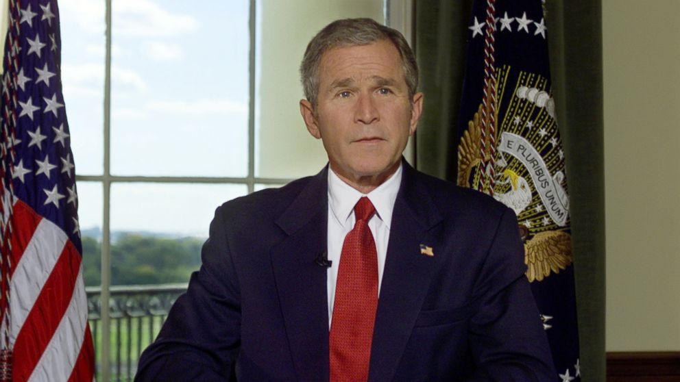 President Bush poses for a photo in the Treaty Room of the White House in Washington, D.C., Oct. 7, 2001, after announcing airstrikes on Afghanistan.