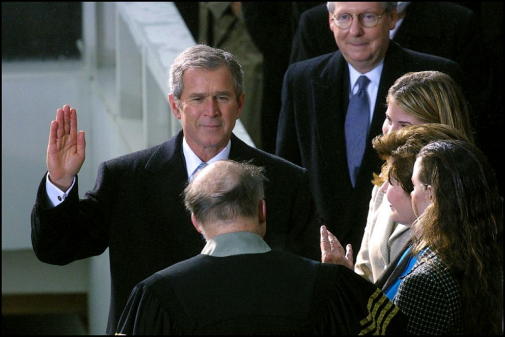 PHOTO: George W. Bush, flanked by his wife Laura and daughters Jenna and Barbra, is sworn in as President during a ceremony at the Capitol building in Washington, DC, Jan. 20, 2001.