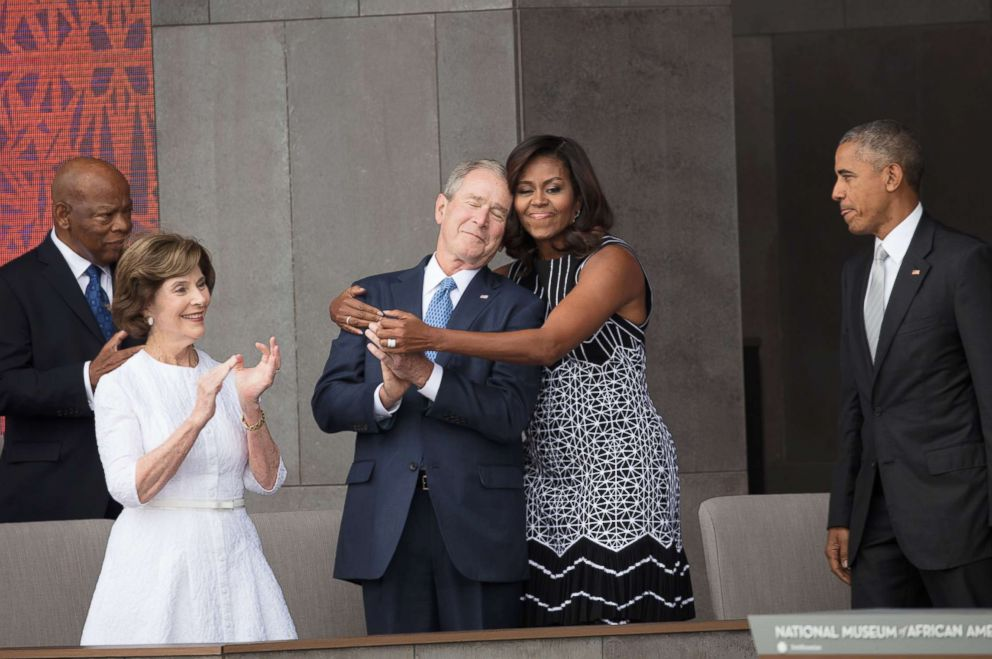 PHOTO: First Lady Michelle Obama hugs former President George W Bush at the opening of the National Museum of African American History and Culture in Washington, Sept. 24, 2016.