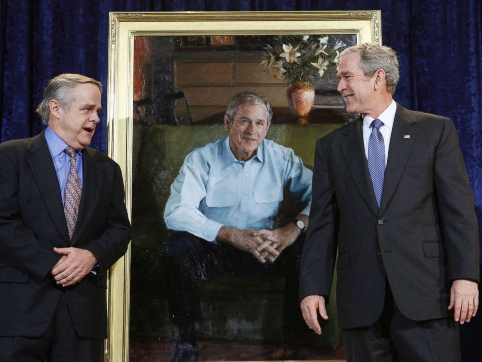 PHOTO: President George W. Bush smiles at artist Robert Anderson after unveiling his portrait at the National Portrait Gallery, Dec. 19, 2008, in Washington.