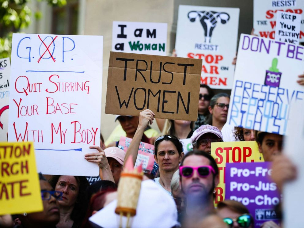 PHOTO: Women hold signs during a protest against recently passed abortion ban bills at the Georgia State Capitol building, in Atlanta, May 21, 2019.