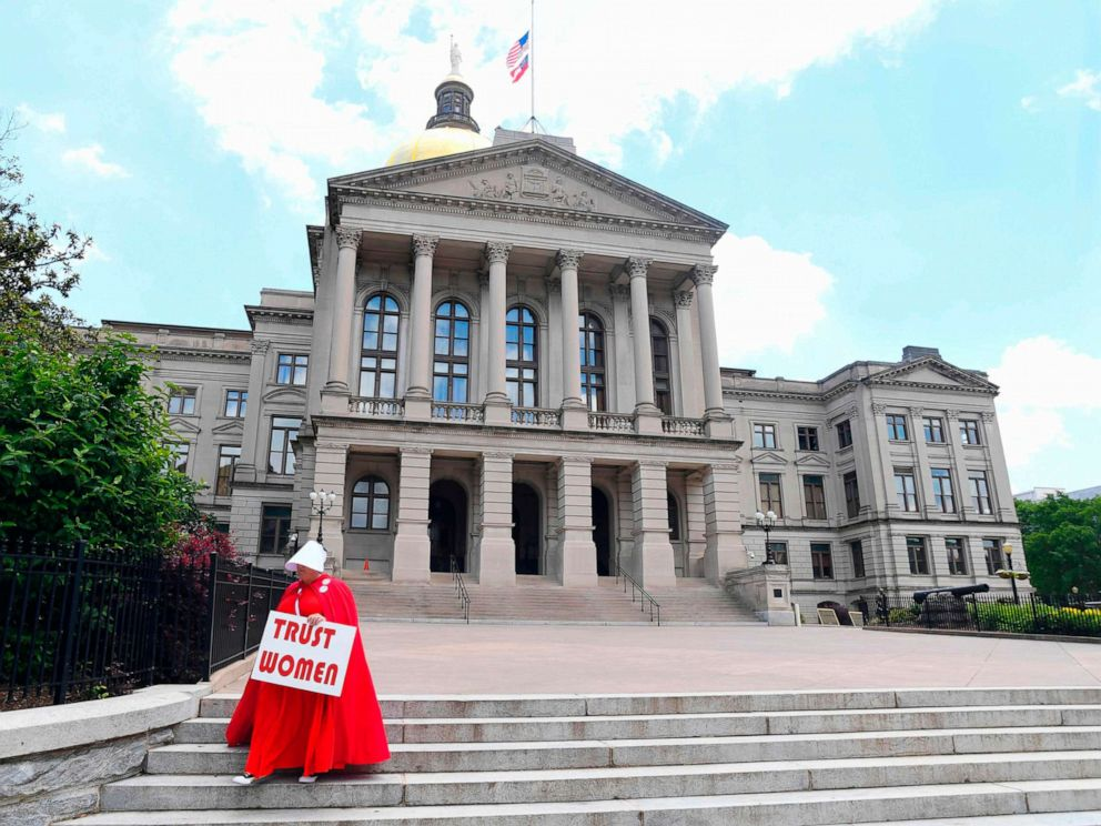 PHOTO: Activist Tamara Stevens with the Handmaids Coalition of Georgia leaves the Georgia Capitol, May 16, 2019 in Atlanta.