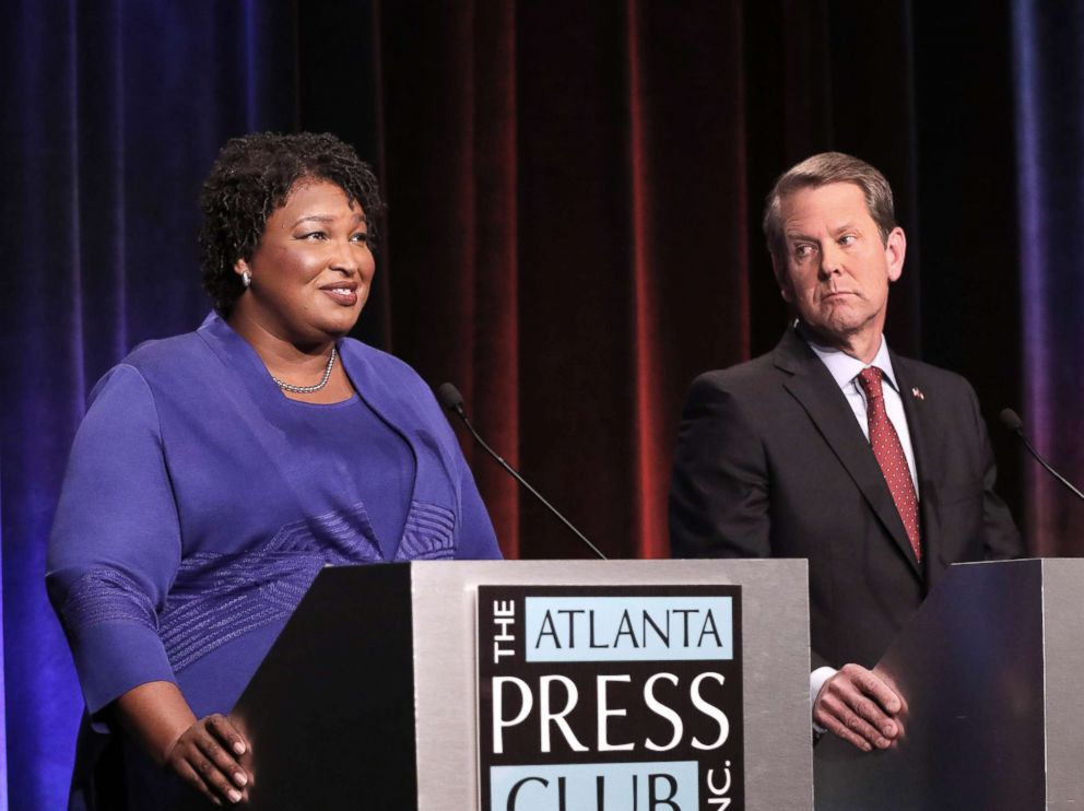 PHOTO: Georgia gubernatorial candidates (L-R) Democrat Stacey Abrams and Republican Brian Kemp debate in an event that also included Libertarian Ted Metz on Oct. 23, 2018, in Atlanta.