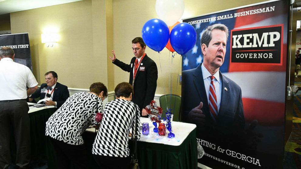 Guests sign in to attend an election night results party for Georgia Secretary of State Brian Kemp, Republican primary candidate for governor, May 22, 2018, in Athens, Ga.