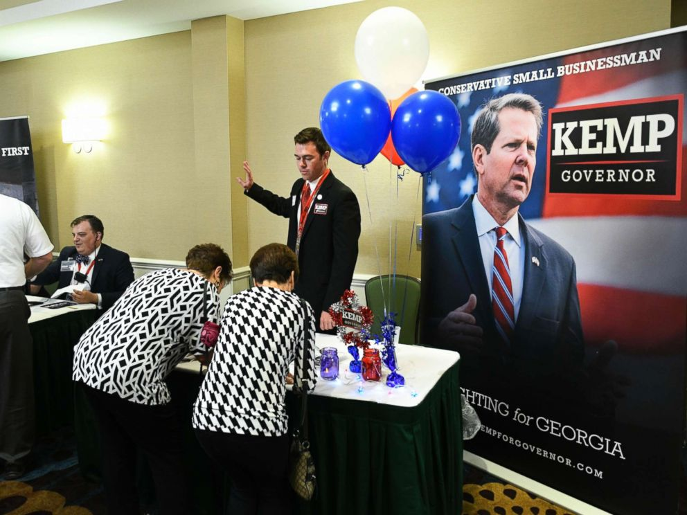 PHOTO: Guests sign in to attend an election night results party for Georgia Secretary of State Brian Kemp, Republican primary candidate for governor, May 22, 2018, in Athens, Ga.