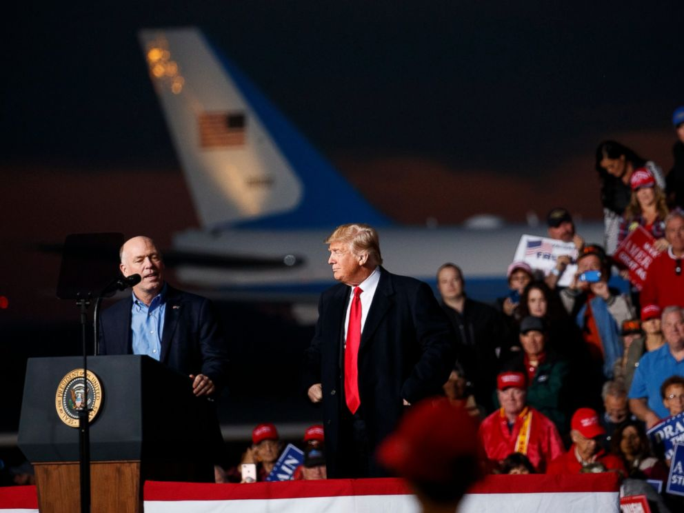 PHOTO: Rep. Greg Gianforte, R-Mont., speaks as President Donald Trump stands right during a campaign rally at Minuteman Aviation Hangar, Thursday, Oct. 18, 2018, in Missoula, Mont.