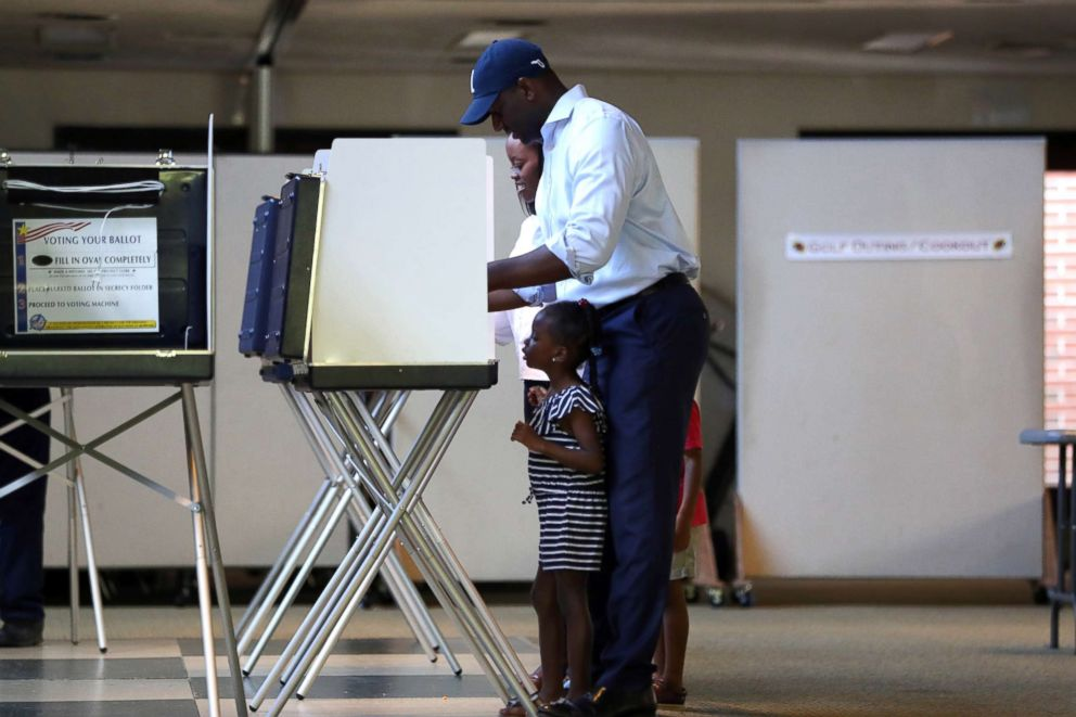 PHOTO: Florida gubernatorial candidate Andrew Gillum casts his vote, with daughter Caroline, 4, by his side at the Good Shepherd Catholic Church polling location, Aug. 28, 2018, Tallahassee, Fla.