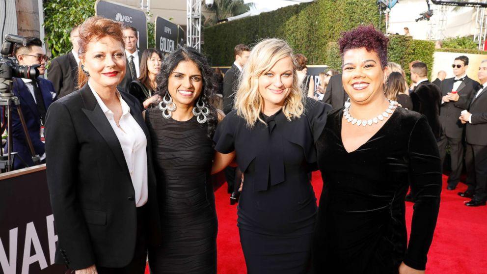 Susan Sarandon, activist Saru Jayaraman, actor Amy Poehler and activist Rosa Clemente arrive to the 75th Annual Golden Globe Awards held at the Beverly Hilton Hotel on Jan. 7, 2018.