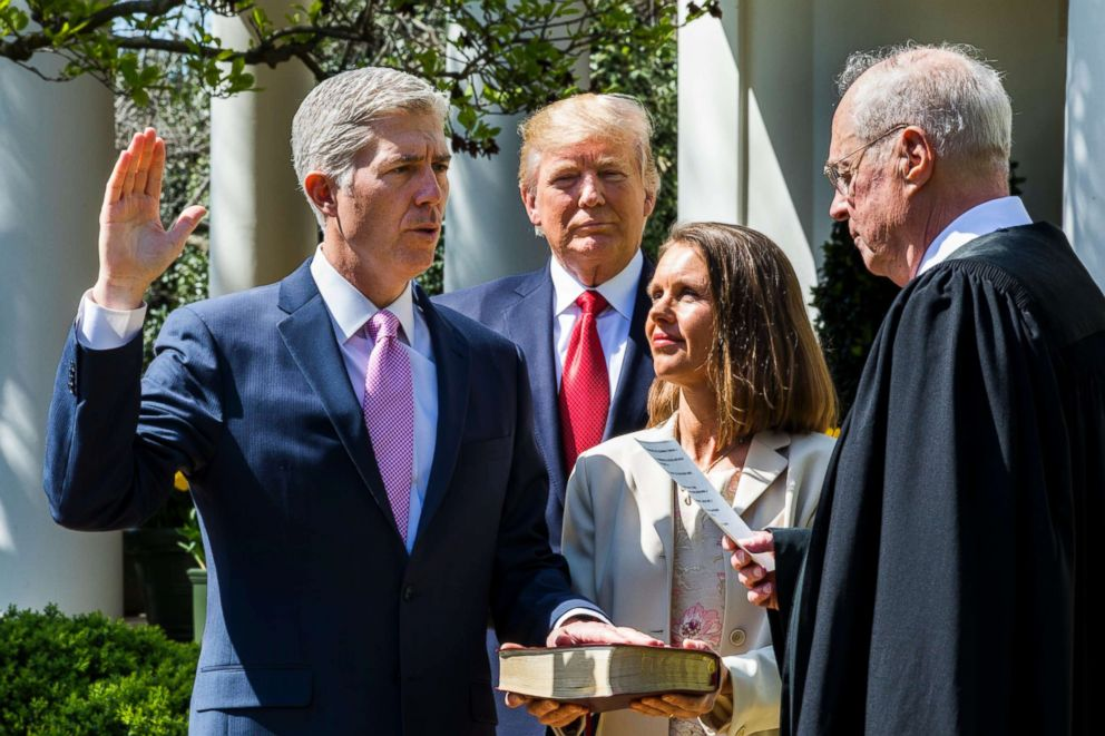 Justice Anthony M. Kennedy, right,  administers the judicial oath to the US Supreme Court's newest member, Neil M. Gorsuch.