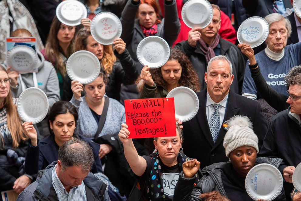 PHOTO: Federal employees holding plates with writing on them stage a rally to call for a vote on the shutdown on Capitol Hill in Washington, Jan. 23, 2019.
