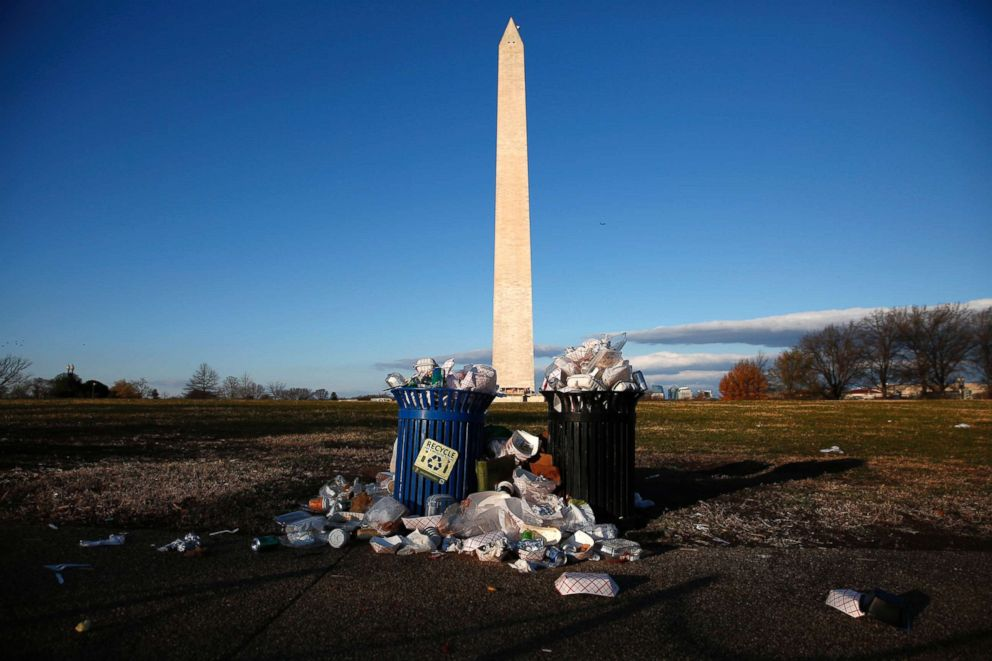 Trash begins to accumulate along the National Mall near the Washington Monument due to a partial shutdown of the federal government in Washington, D.C., Dec. 24, 2018.