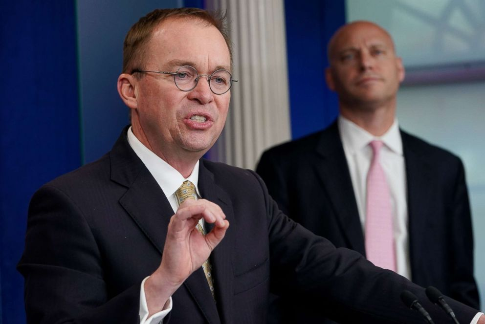 PHOTO: Office of Management and Budget Director Mick Mulvaney, left, speaks as Legislative Affairs Director Marc Short, right, looks on during a press briefing at the White House on Jan. 20, 2018.