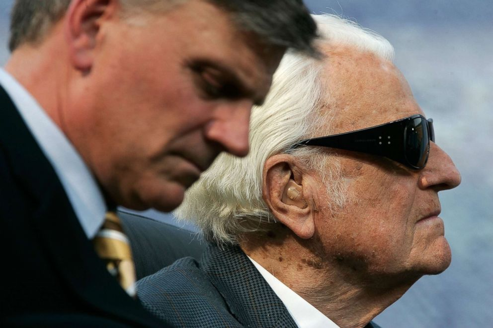 Evangelist Billy Graham (R) and his son Franklin (L) take part in the Metro Maryland 2006 Festival, July 9, 2006, in Baltimore.
