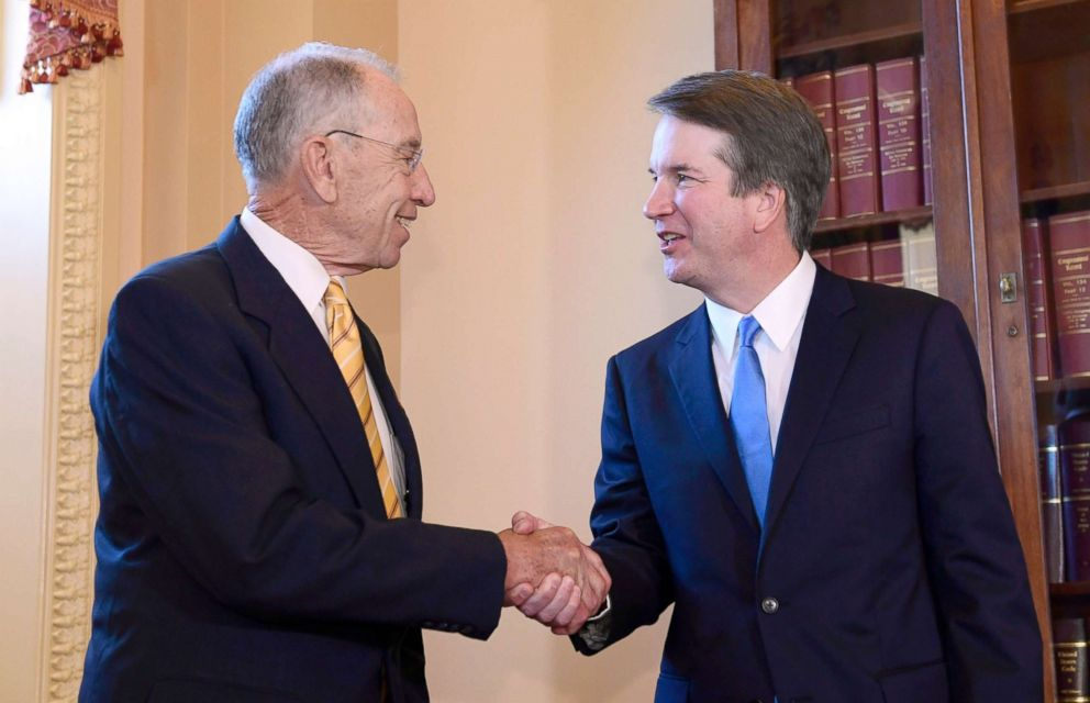 Sen. Chuck Grassley, left, shakes hands with Supreme Court nominee Brett Kavanaugh on Capitol Hill in Washington, July 10, 2018.