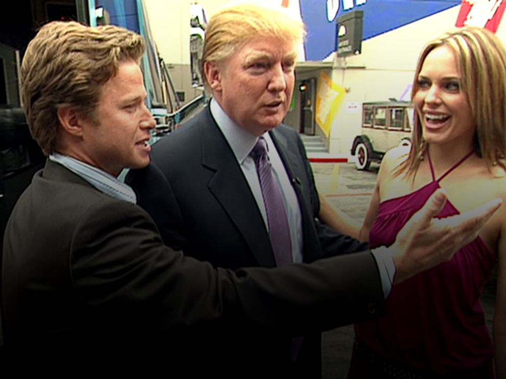 PHOTO: In this 2005 frame from video, Donald Trump (center) prepares for an appearance on Days of Our Lives with actress Arianne Zucker (right). He is accompanied to the set by Access Hollywood host Billy Bush (left).