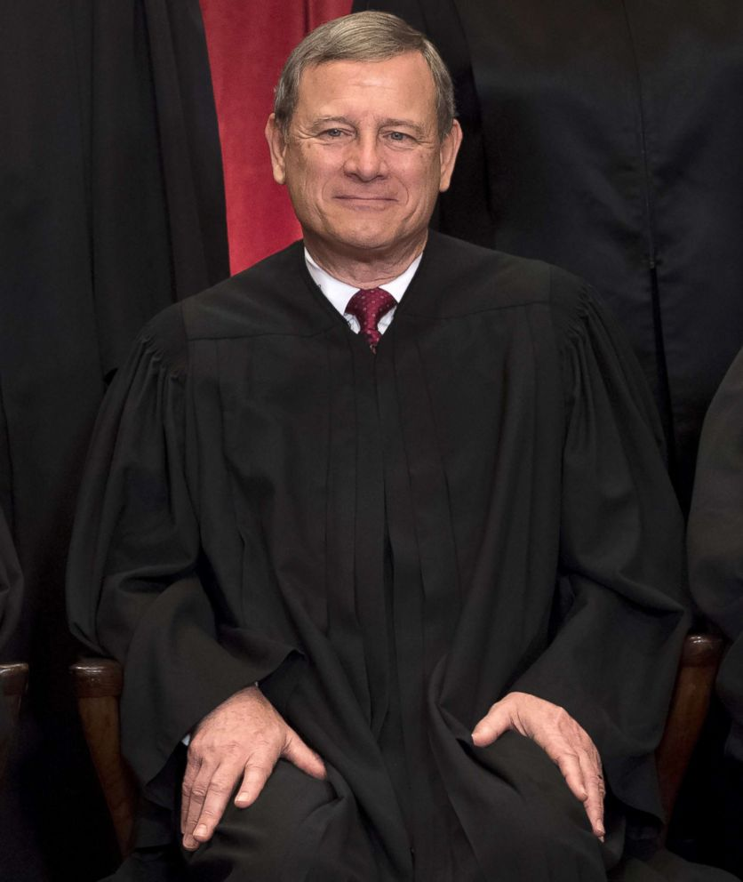Chief Justice John Roberts sits for an official photo with other members of the Supreme Court in the Supreme Court in Washington, DC, June 1, 2017.