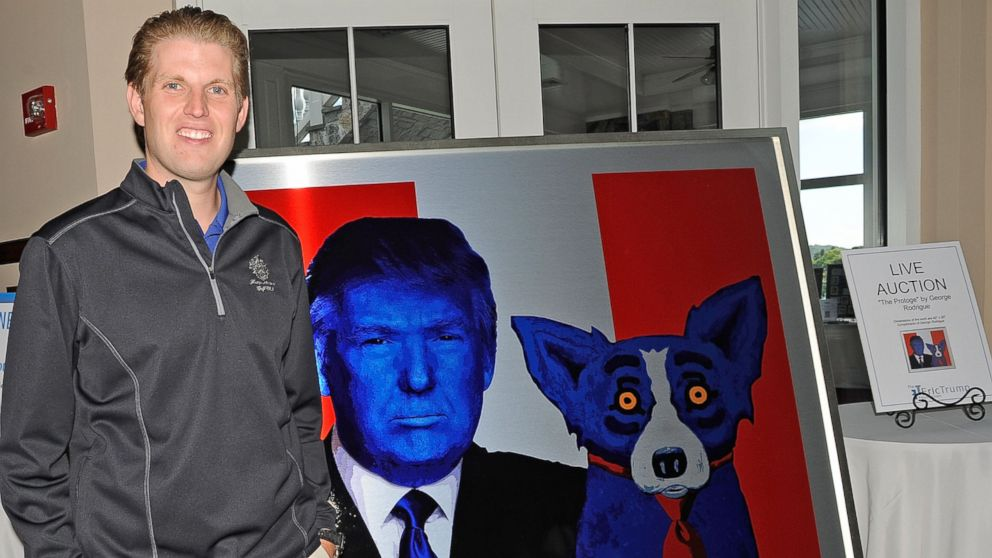 """Eric Trump stands next to a painting called """"The Protoge"""" by George Rodrigue at his foundation's 6th annual golf invitational benefiting The St. Jude Children's Research Hospital at Trump National Golf Club Westchester on Sept. 10, 2012 in Briarcliff Manor, N.Y."""