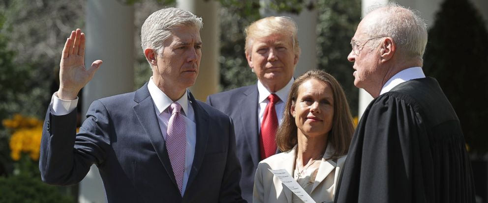 PHOTO: Supreme Court Associate Justice Anthony Kennedy administers the judicial oath to Judge Neil Gorsuch as President Donald Trump looks on during a ceremony in the Rose Garden at the White House April 10, 2017 in Washington.