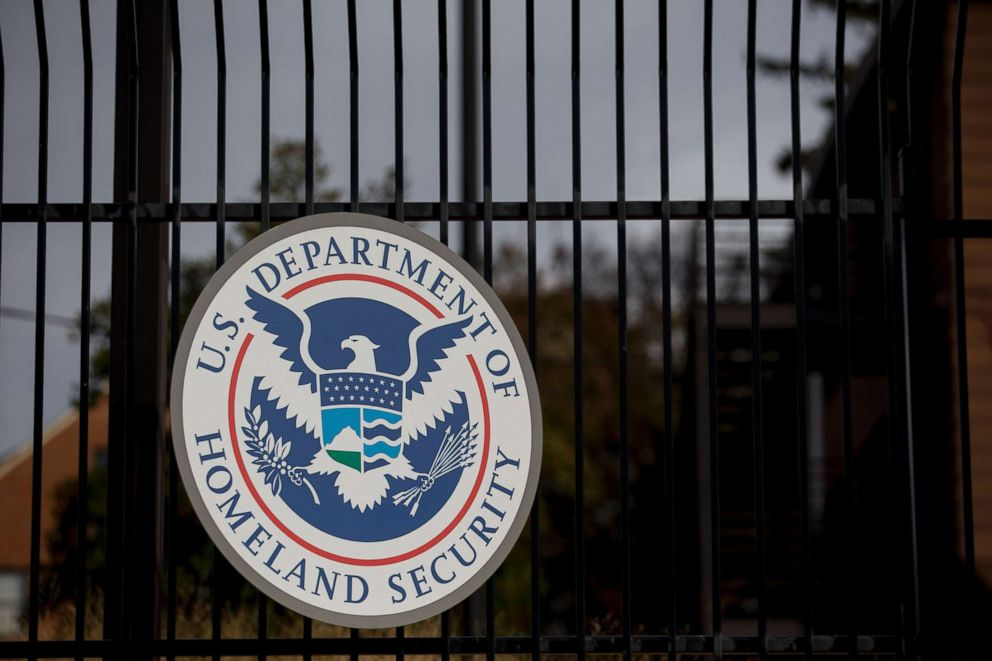 PHOTO: The Department of Homeland Security seal hangs on a fence at the agencys headquarters in Washington, Dec. 11, 2014.