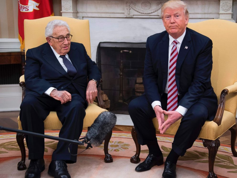 PHOTO: US President Donald Trump speaks with former Secretary of State Henry Kissinger during a meeting in the Oval Office of the White House in Washington, May 10, 2017.