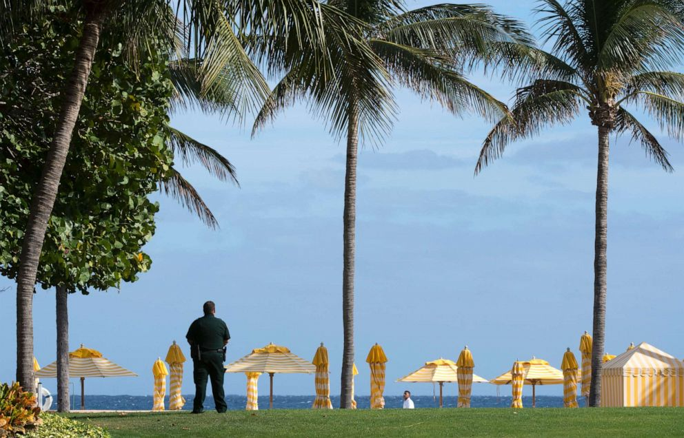 A security agent stands guard at the Mar-a-Lago Club where President-elect Donald Trump is holding meetings on Dec. 30, 2016, in Palm Beach, Fla.