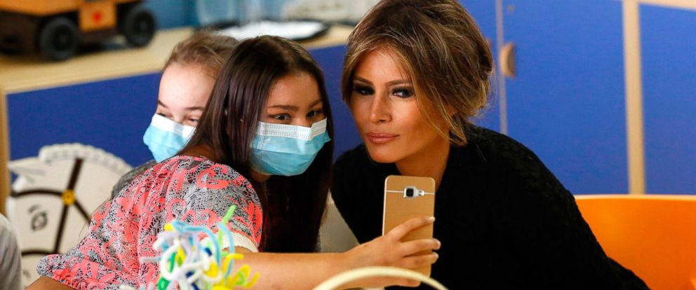 PHOTO: First lady Melania Trump poses for a selfie with a young patient during a visit to a pediatric hospital, on May 24, 2017 in Rome.