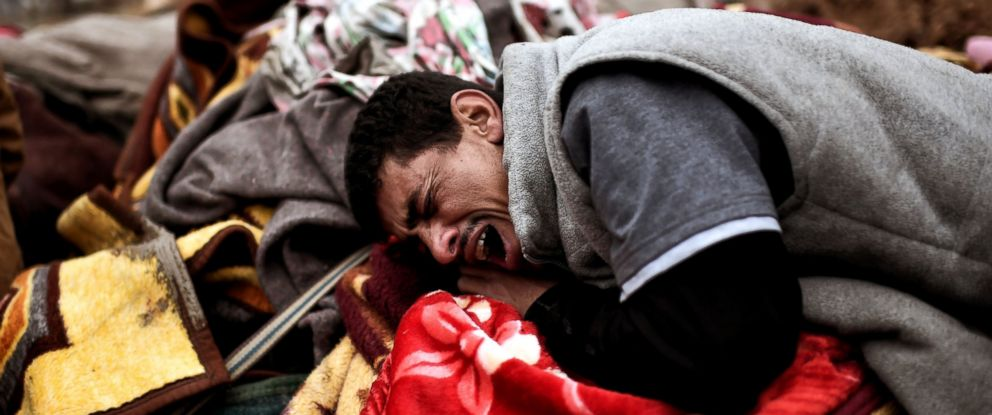 PHOTO: Relatives mourn as bodies of Iraqi residents of west Mosul killed in an airstrike targeting Islamic State (IS) group jihadists are placed and covered with blankets on carts, March 17, 2017.