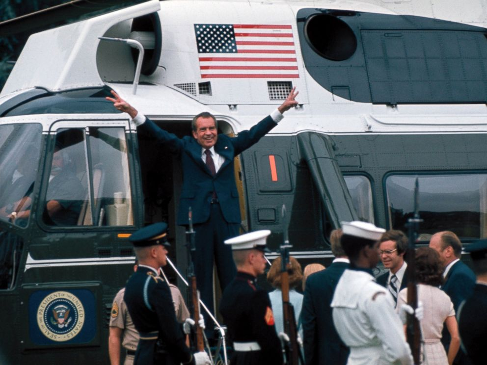 PHOTO: President Richard Nixon raises his hands with his trademark V sign in the doorway of a helicopter after leaving the White House following his resignation over the Watergate scandal, Aug. 9, 1974.