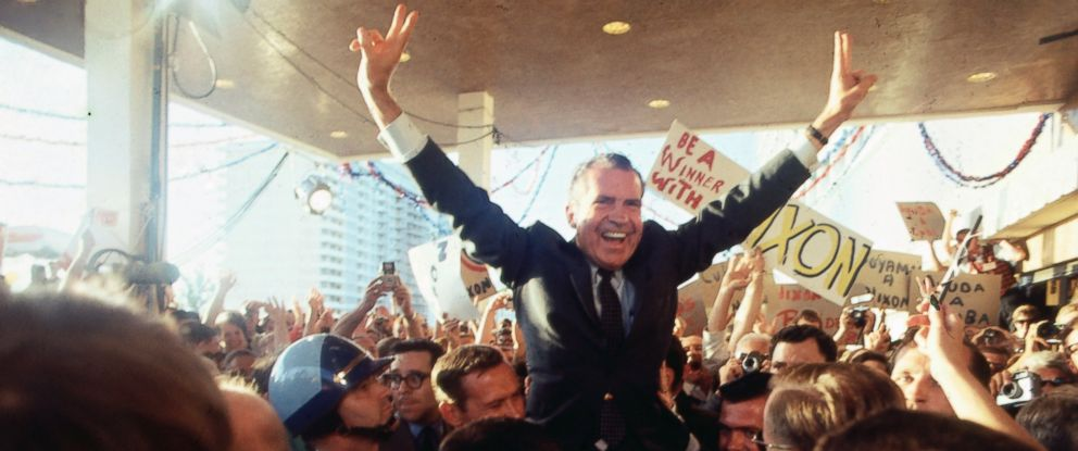 PHOTO: Richard Nixon is surrounded by supporters as he arrives at the Hilton Plaza Hotel, in Miami, Aug. 05, 1968.
