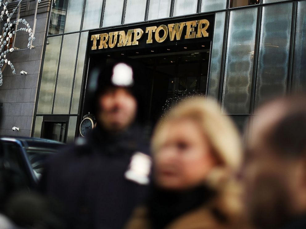 PHOTO: People stand outside of Trump Tower during a press conference on Dec. 9, 2016 in New York.