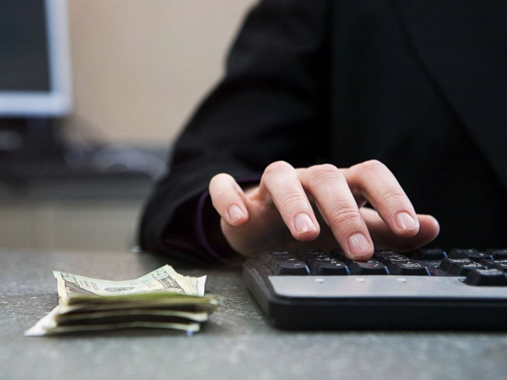 PHOTO: Cash sits on a counter in an undated stock photo.