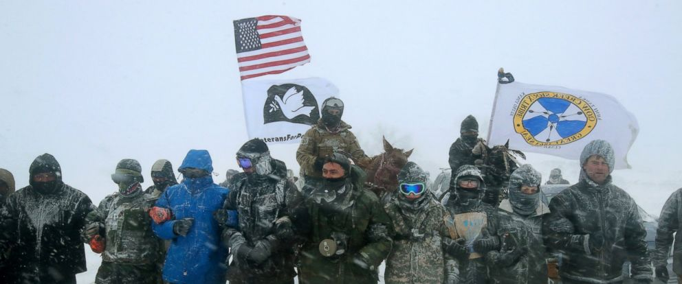"PHOTO: Despite blizzard conditions, military veterans march in support of the ""water protectors"" at Oceti Sakowin Camp on the edge of the Standing Rock Sioux Reservation, Dec. 5, 2016, outside Cannon Ball, North Dakota."