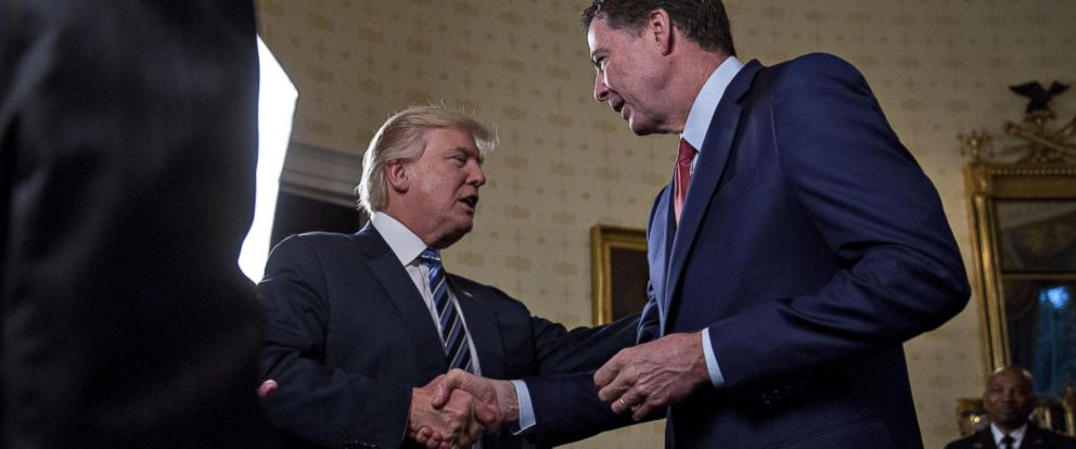 PHOTO: President Donald Trump shakes hands with James Comey, director of the FBI, during areception in the Blue Room of the White House in Washington, D.C., Jan. 22, 2017.
