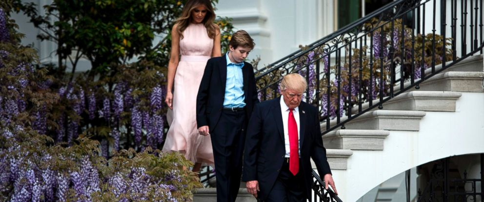 PHOTO: First lady Melania Trump, Barron Trump and President Donald Trump walk down to the Easter Egg Roll on the South Lawn of the White House April 17, 2017 in Washington, D.C.