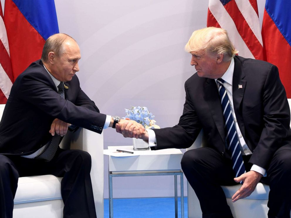 PHOTO: President Donald Trump and Russias President Vladimir Putin shake hands during a meeting on the sidelines of the G20 Summit in Hamburg, July 7, 2017.