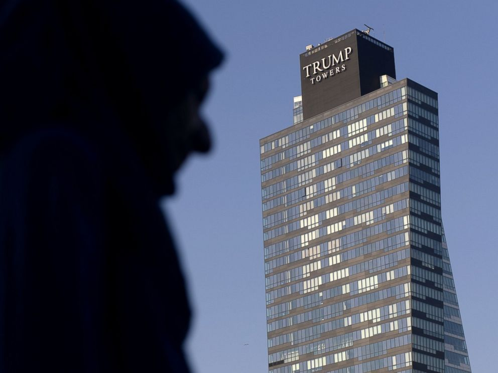 PHOTO: A woman walks past the Trump Towers building in Istanbul on July 30, 2015.