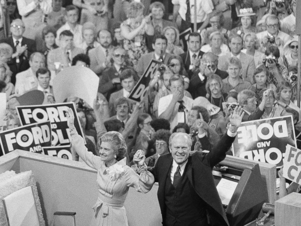 PHOTO: President Gerald Ford, holding hands with his wife Betty, turns to the cheering crowd behind the podium at the closing session of the GOP convention, Aug. 19, 1976.
