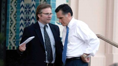 PHOTO: Mitt Romney speaks with his traveling press secretary Eric Fehrnstrom before a press conference after a campaign rally at the San Diego County Admin. Building, San Diego Calif., Jan. 31, 2008.