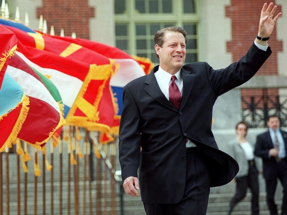 PHOTO: Al Gore waves as he walks past a row of flags at the start of the Commemoration Ceremony of the 50th Anniversary of the North Atlantic Treaty Organization in New York, April 21, 1999.