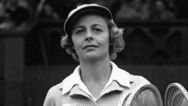 PHOTO: Alice Marble of the USA walks onto the Wimbledon court to play the Women's Singles Final, July 8, 1939.