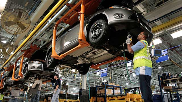 PHOTO: Ford employees working assembly line