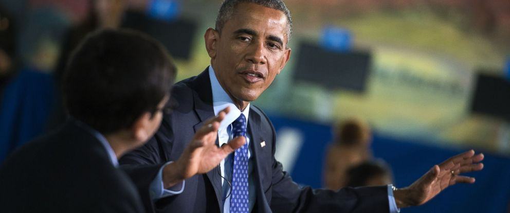 """PHOTO: President Barack Obama responds to a question during a """"Virtual Field Trip"""" with middle school students from around the country at Anacostia Library, April 30, 2015 in Washington."""