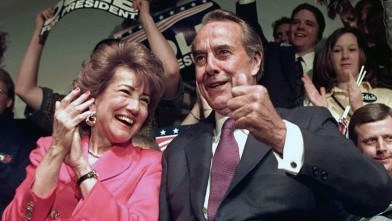 PHOTO: Republican presidential candidate US Senator Bob Dole and wife Elizabeth Dole react to supporters cheers.