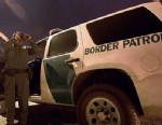 PHOTO: A member of the US Customs and Border Protection searches for illegal immigrants in El Paso, Texas, on April 6, 2011.