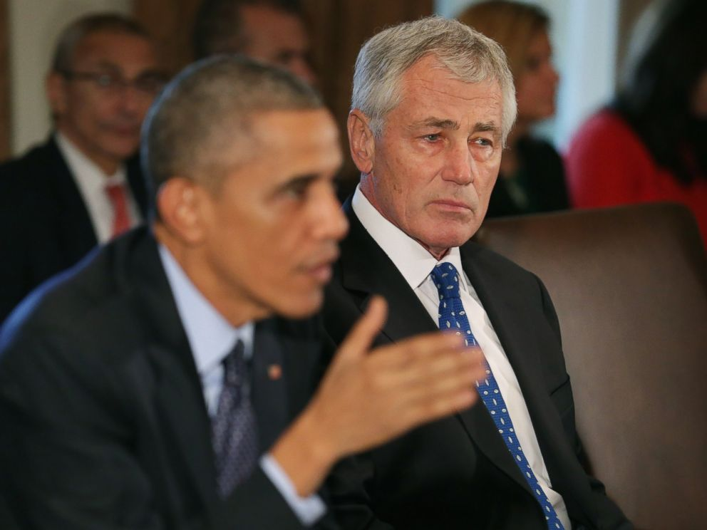 PHOTO: Defense Secretary Chuck Hagel, right, listens as President Barack Obama speaks to members of the news media.