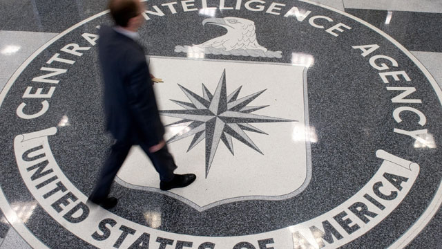 PHOTO: A man crosses the Central Intelligence Agency logo in the lobby of CIA Headquarters in Langley, Virginia, Aug. 14, 2008.