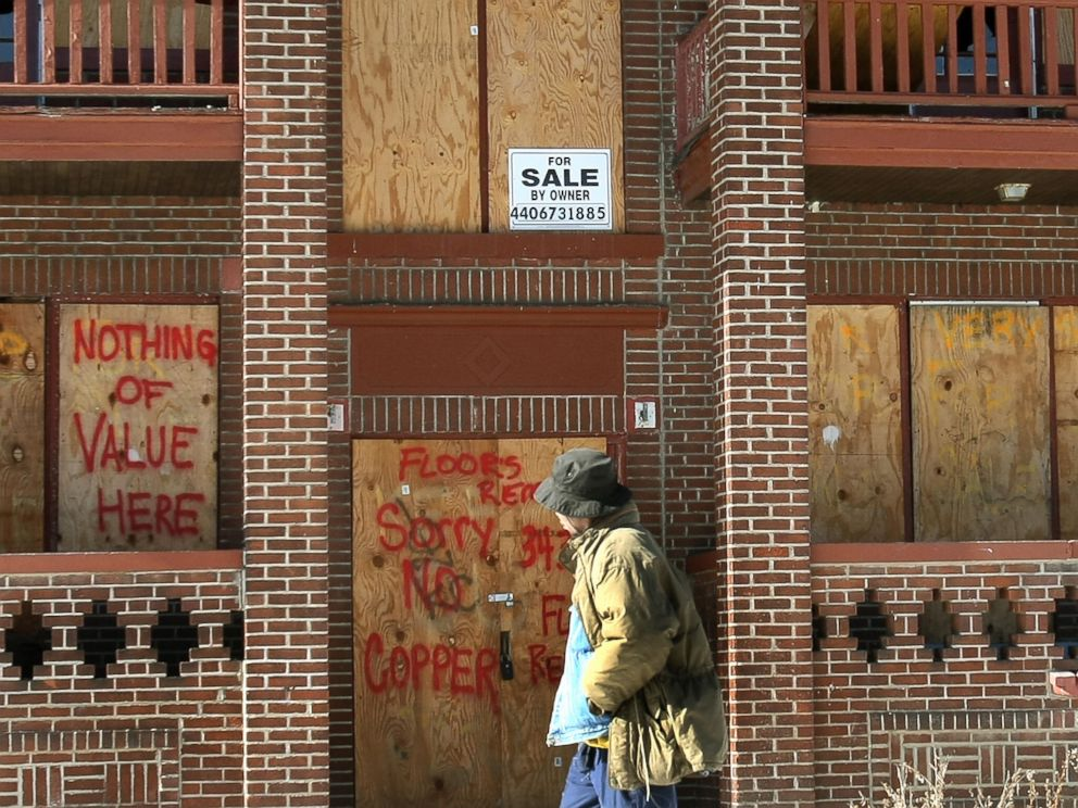 PHOTO: A resident walks past a boarded up building in the Mount Pleasant section of Cleveland, Ohio, Jan. 25, 2008.