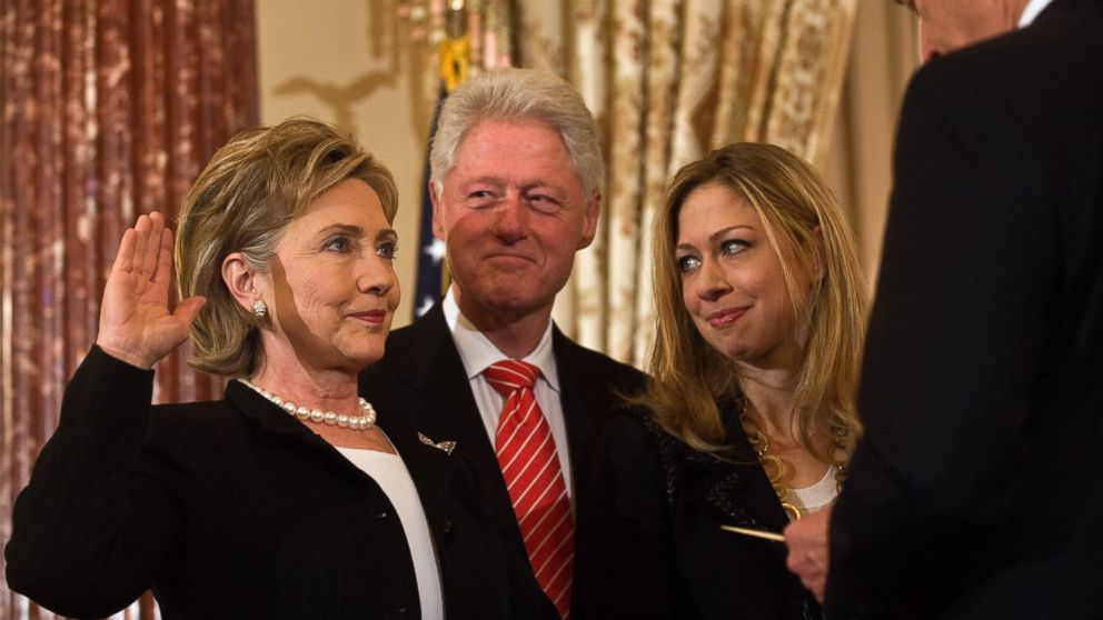 US Secretary of State Hillary Clinton is ceremonially sworn in by Vice President Joe Biden as her husband former president Bill Clinton and daughter Chelsea look on at the State Department in Washington, Feb. 2, 2009.