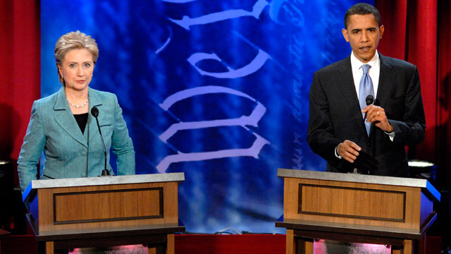 PHOTO: Barack Obama, U.S. senator from Illinois and Hillary Clinton, U.S. senator from New York, prepare to continue a debate at the National Constitution Center in Philadelphia, PA in this April 16, 2008 file photo.