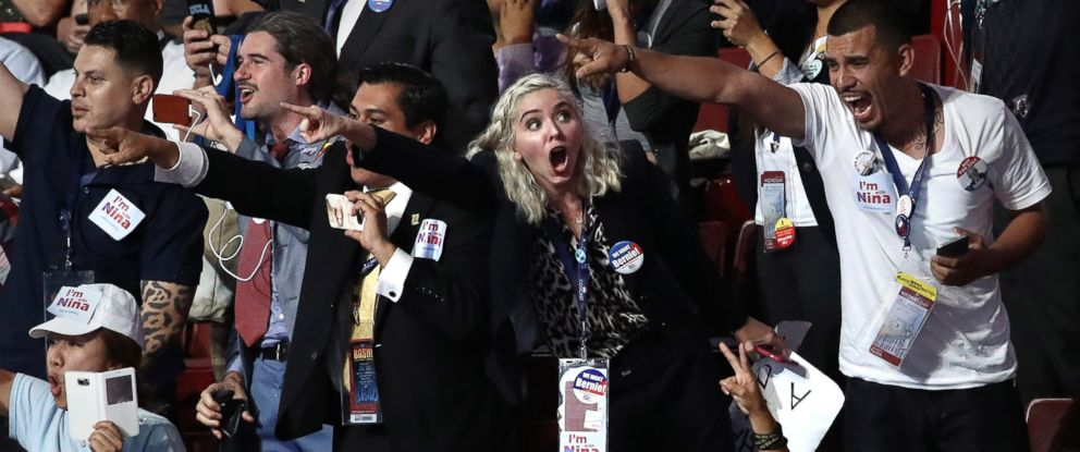 PHOTO: Attendees chant during former Secretary of Defense Leon Panettas speech on the third day of the Democratic National Convention, July 27, 2016, in Philadelphia.